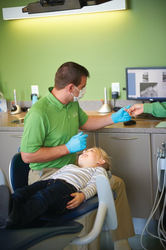 Dr. Healy preparing a young patient for fluoride and dental sealant treatment at Tiny Teeth Pediatric Dentistry.