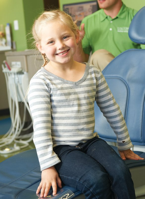 A girl smiling at Tiny Teeth Pediatric Dentistry