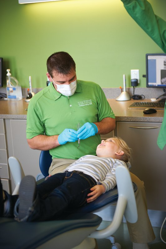 Dr. Healy examining a child's teeth for mouthgurd at Tiny Teeth Pediatric Dentistry