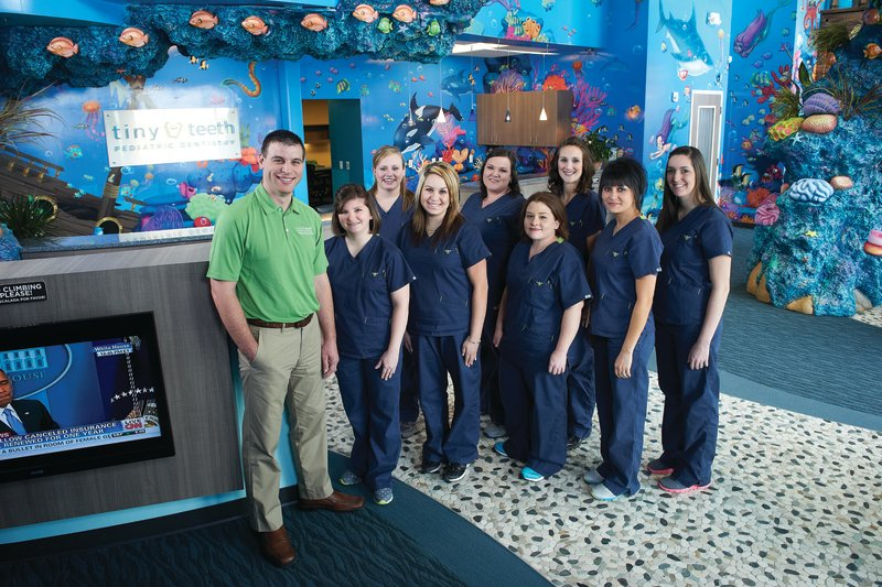 Dr. Healy with his team at Tiny Teeth Pediatric Dentistry, in Wichita, KS