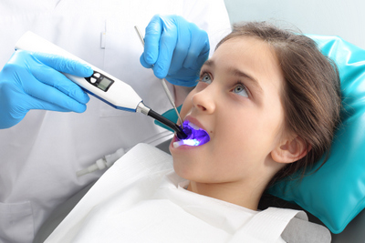 A child receiving sealants at Tiny Teeth Pediatric Dentistry